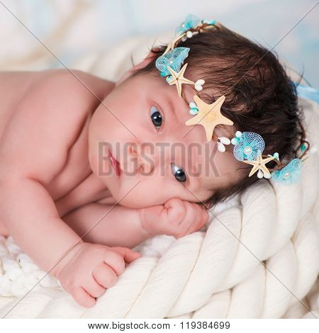 Close Portrait Of A Sleeping Newborn Girl In The Maritime Hoop Of Starfish And Pearls