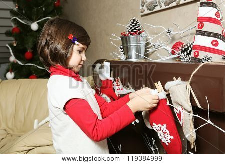 Child Girl Decorating Room For Christmas