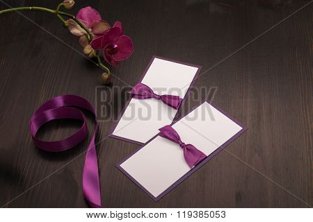 Composition With Handmade Cards And Orchid Flower In Purple Colors