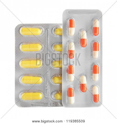 Varicolored pills in the blister pack, isolated on white