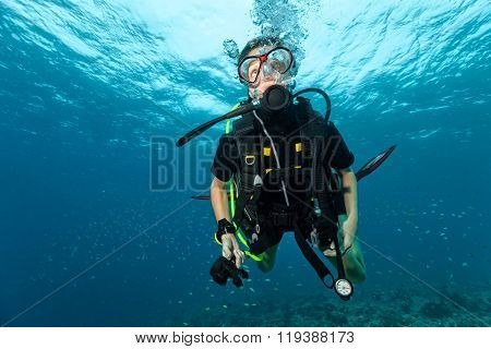 Young female scuba diver doing safety stop