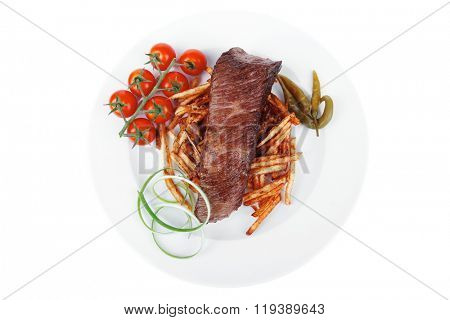 meat food grill beef on potato chips with fresh tomato and hot green peppers isolated on white background