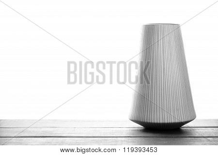 decoration vase on wooden plank in black and white