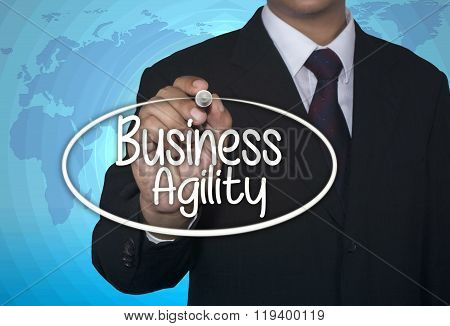 Business concept handwriting marker and write Business Agility over light blue background with world