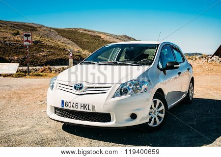 White color Toyota Auris car on Spain nature landscape