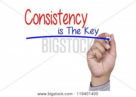 Business concept handwriting marker and write Consistency is The Key isolated on white background