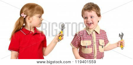 Little girl and boy with a wrench on the white