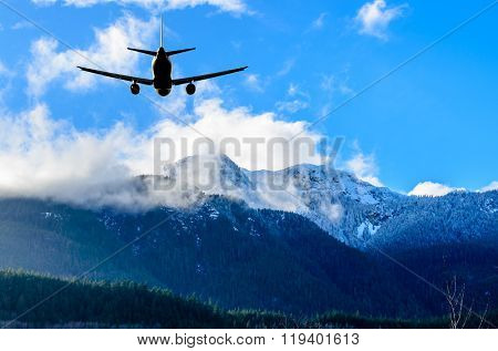 flight of the airplane (jet) over beautiful sky and snow mountains