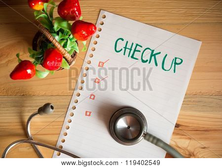 Health Check Up List Concept, Top View Of Paper Check List And Stethoscope On Wood Table , Digital E