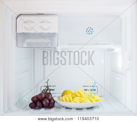 Diet Fruit, Pineapple And Orange Dish With Grape Put On The Freezer Fridge