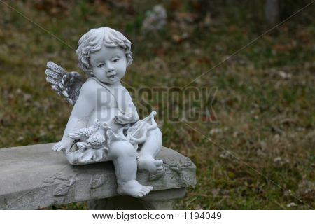 Cherub Or Angel On Bench
