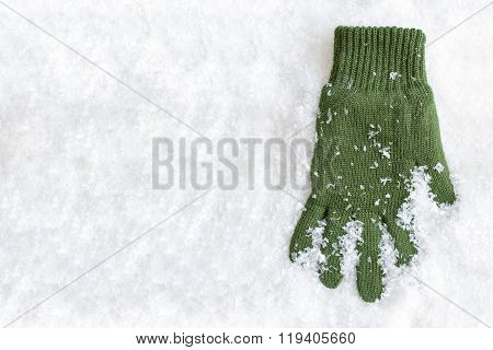 Glove Laying In Snow