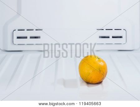 Close Up Of Diet Fruit, Orange Put On The Freezer Fridge