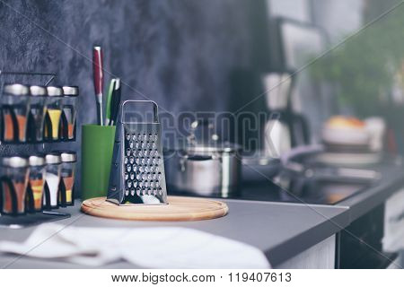 Modern kitchen table with grater, cutting board and spices