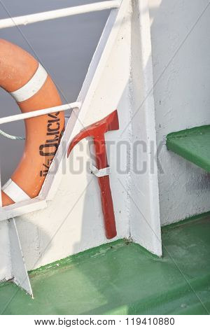 firefighters red ax on white iron ship board.