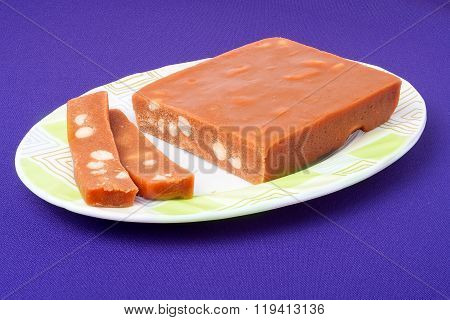 Pieces of sherbet isolated on violet background