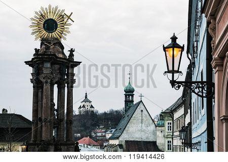Banska Stiavnica Historical Cityscape With Monumental Plague Column, New Castle And Saint Catherine´