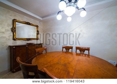 Closeup of wooden dining table in home interior