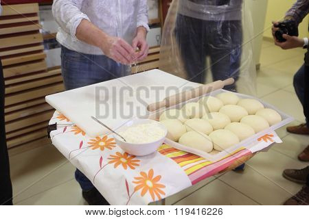 The Man Strews A Flour Dough For Pelmeni