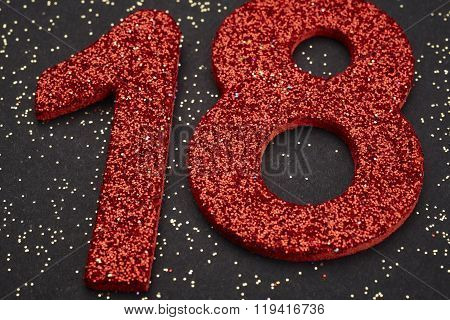 Number Eighteen Red Color Over A Black Background. Anniversary