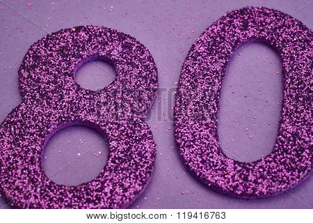 Number Eighty Purple Color Over A Purple Background. Anniversary