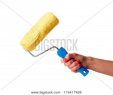 paint roller in hand on a white background