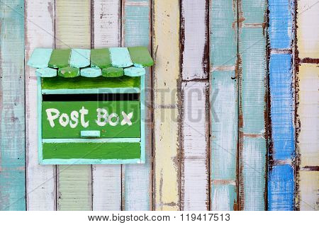 Green Wooden Mailbox With Wooden Background