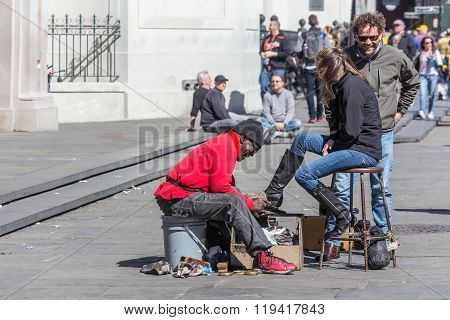 New Orleans, La/usa - Circa February 2016: Shoeshiner Or Boot Polisher Man Cleans Lady's Boots At Ja