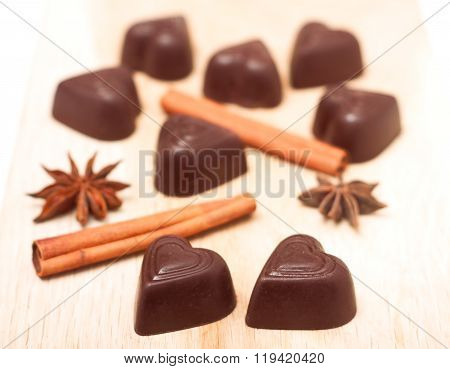 Chocolate candies shaped heart on a wooden background
