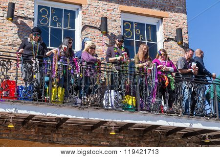 New Orleans, La/usa - Circa February 2016: People Throwing Beads From Balconies During Mardi Gras In