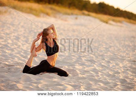 Beach yoga session by polish sea