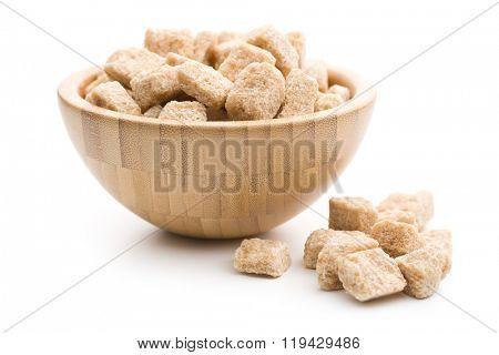 unrefined cane sugar in wooden bowl