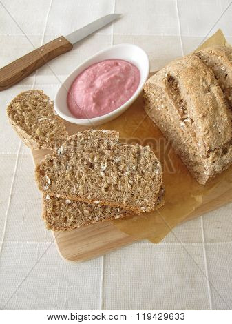 Whole grain bread with vegetable spread from beetroot and horseradish