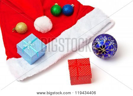 Santa Claus red and white hat toy bubbles and christmas gifts on white background.