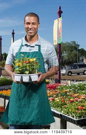 Shop assistant holding flowers
