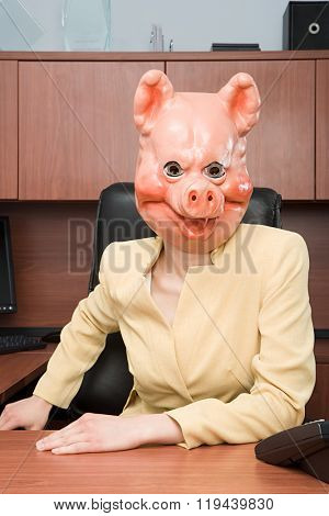 Portrait of businesswoman in a pig mask