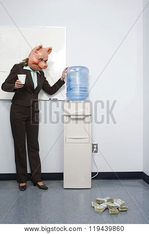 Businesswoman in pig mask looking at money