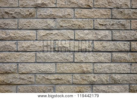 Beige tile cladded stone wall texture