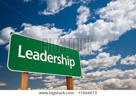 Leadership Green Road Sign with Copy Room Over The Dramatic Clouds and Sky.