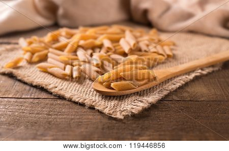 Bowl Of Penne Noodles In Rustic Style