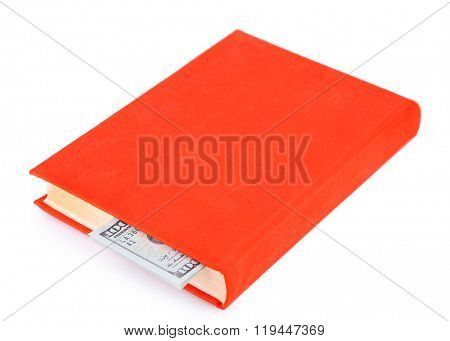 Red book with nested dollar banknotes, isolated on white. Stash of money