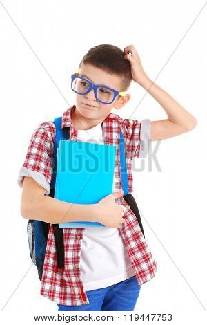 Funny little boy with plastic glasses and back pack scratching his head, isolated on white