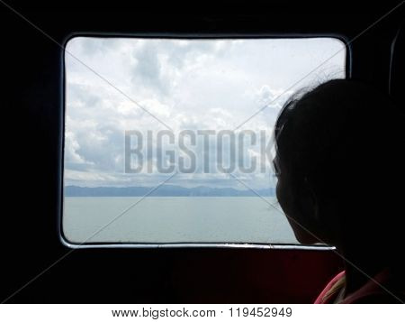 Young Woman Traveling And Looking Out Window