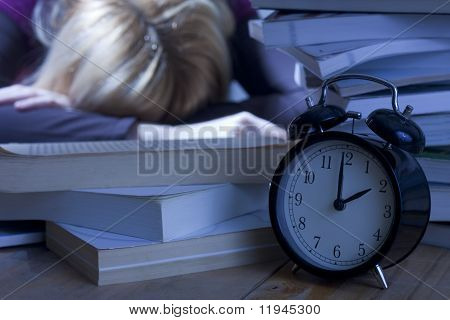 Tired Student Sleeping on Books