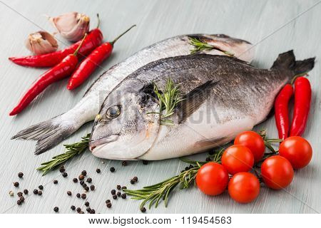 Raw Fresh Dorado Fish With Vegetables And Spices
