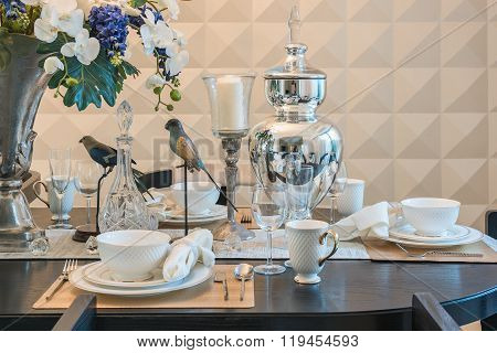 Table Set On Wooden Table In Luxury Dinning Room