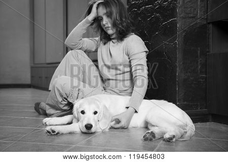 Depressed girl with her dog