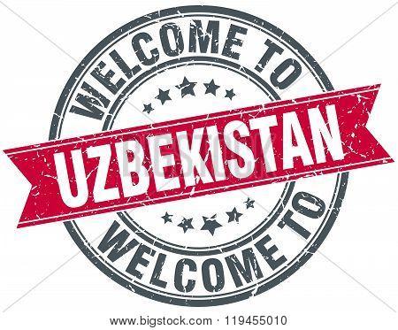 welcome to Uzbekistan red round vintage stamp