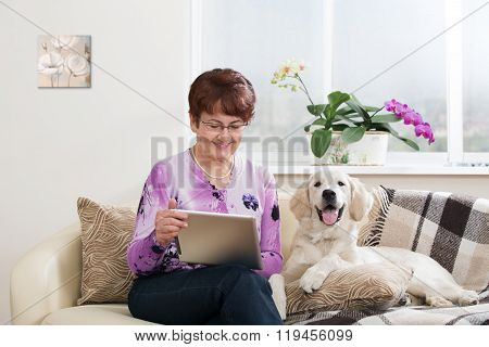 Modern senior woman with dog