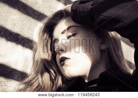 Portrait In Profile Of A Beautiful Teenage Girl